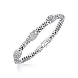 Sterling Silver Rhodium Popcorn Bangle with Diamond Barrel Stations (.17ct tw)